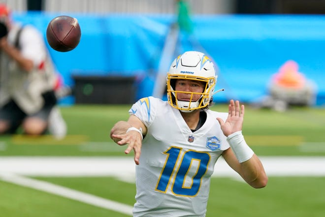 Los Angeles Chargers quarterback Justin Herbert had 311 yards passing in his NFL debut Sunday in a 23-20 overtime loss to the Kansas City Chiefs in Inglewood, Calif.