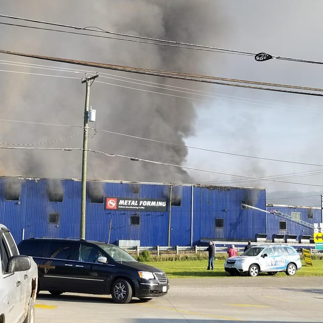 Firefighters battled an industrial blaze Tuesday at Colfor Manufacturing in Malvern.