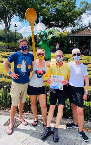 FUN AT EPCOT: Matthew Gilligan (executive chef, Commander's Shellfish Camp, St. Augustine), fiancé Erin Bauserman (Jacksonville), dished up some fun with Ratatouille's Chef Remy at EPCOT, Disney World, while Taking The Record Along with Erika and David Bauserman (St. Augustine Beach).