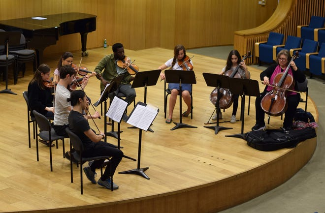 Cellist Merry Peckham, right, works with students in the Perlman Music Program/Suncoast in Sarasota in 2018.