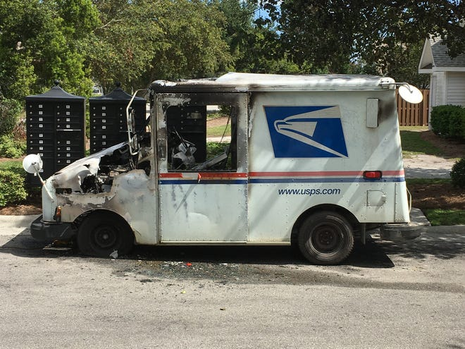 A USPS mail truck caught fire this week, and the carrier didn't hesitate to jump in and try to save the mail and packages inside.