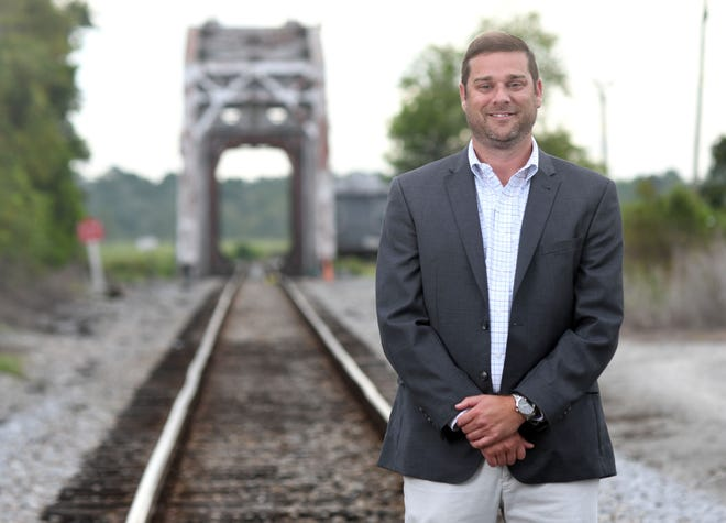 Kevin Lackey, Business Development Professional with Brunswick Business & Industry Development, stands next to the railroad tracks next to Peco in Navassa, N.C., Friday, July 24, 2020. The railroad accessibility helps the organization brings businesses to the county.  Lackey is one of the 40 Under 40 honorees for 2020.