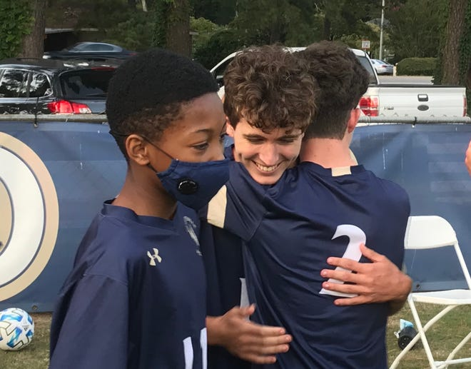 Fayetteville Academy's Anthony Sevilla, center, netted the game-winning goal in the Eagles' 2020 opener against Greenfield School on Monday in Fayetteville.