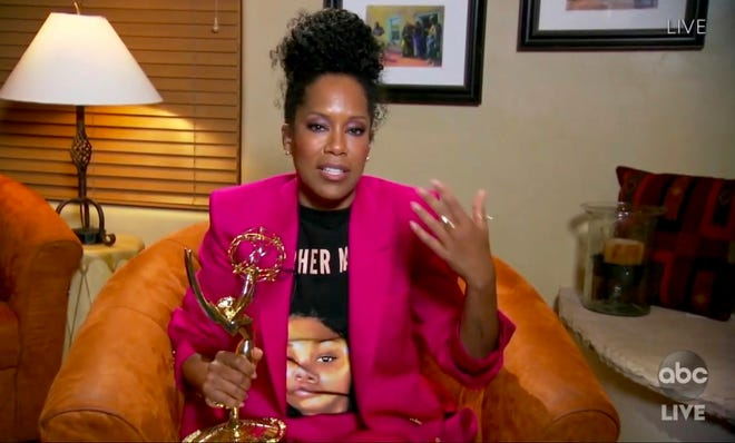 """In this video grab captured on Sunday courtesy of the Academy of Television Arts & Sciences and ABC Entertainment, Regina King accepts the award for outstanding lead actress in a limited series or movie for """"Watchmen"""" during the 72nd Emmy Awards broadcast. [The Television Academy and ABC Entertainment via AP]"""