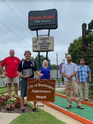 Putt Putt Fun Center, 1340 N. Church St., received the Burlington Tree and Appearance Commission's Community Appearance Award for September. Pictured, from left, are Paul Taylor; Brian Patterson, owner; Pat Pelt; Jason Barnhill; and Chuck Beard. The commission thanks everyone at Putt Putt Fun Center for all of their hard work to make Burlington a more beautiful place.