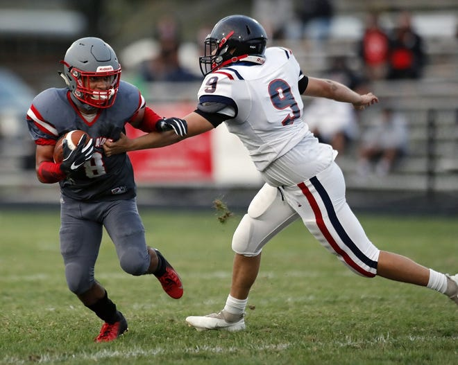 Walnut Ridge's Damien Whaley (left) gets past Centennial's Roderick Peterson and returns a punt for a touchdown in the Scots' 36-14 win in the season opener Sept. 17.