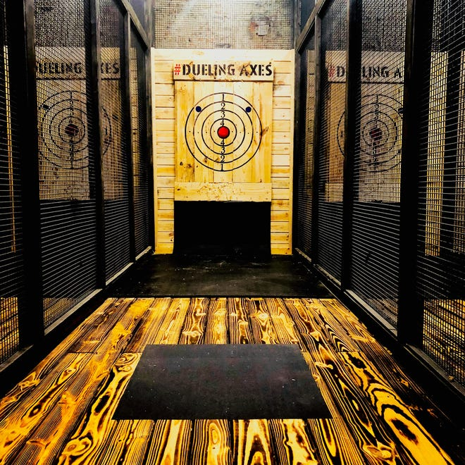 A Dueling Axes ax-throwing bar is coming to northeast Columbus, just outside New Albany.  This is a photo of a lane and target at the Dueling Axes location at 309 S. Fourth St. in downtown Columbus that opened in June 2018.