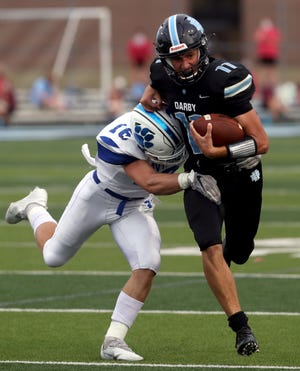 Hilliard Darby's Blake Horvath tries to shake off Hilliard Davidson's Kyle Pepera during their game Aug. 27. The Panthers play host to Thomas Worthington on Friday, Sept. 25.