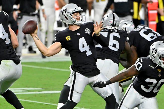Las Vegas Raiders quarterback Derek Carr throws a pass against the New Orleans Saints during the second half Monday, Sept. 21, 2020, in Las Vegas.