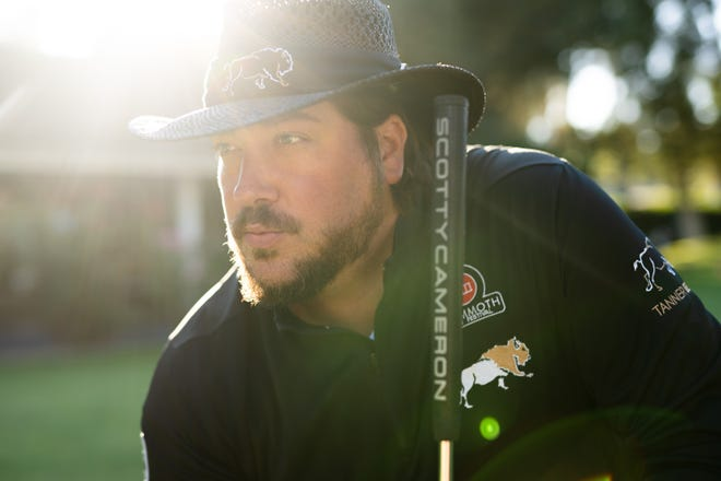 """Tanner Beard, winner of the sports reality show """"Holey Moley,"""" has a line of golf apparel based on the white buffalo, a Scurry County legend."""