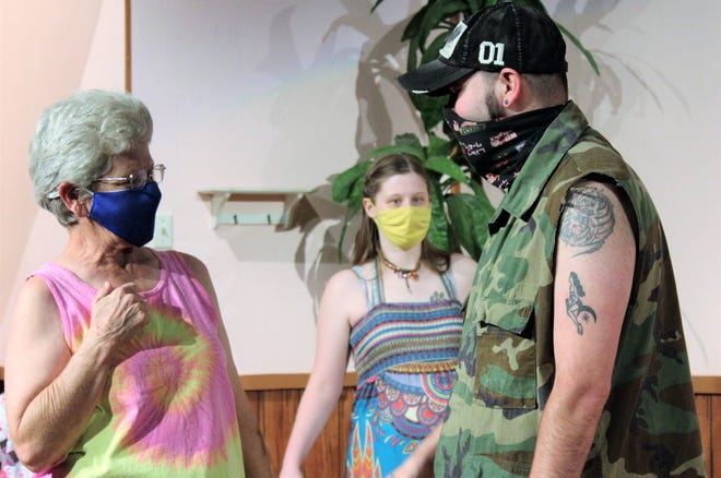 "Norwayne ""Baby"" Crumpler (Keith Rocco, right) addresses Caprice Crumpler, his mother, while Larken Barken (Ashley Parks) listens in this rehearsal scene in face masks for ""Doublewide, Texas,"" which opens a two-weekend run Friday at Abilene Community Theatre."