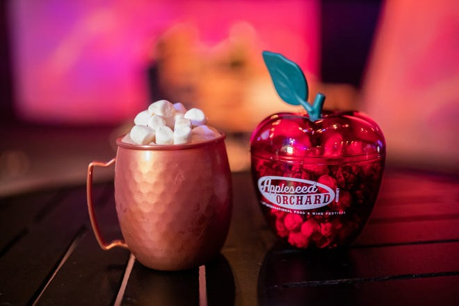 Highlights from the Appleseed Orchard marketplace in the Taste of EPCOT International Food & Wine Festival include the Apple Blossom Sky (left) and Caramel-Apple Popcorn (right).