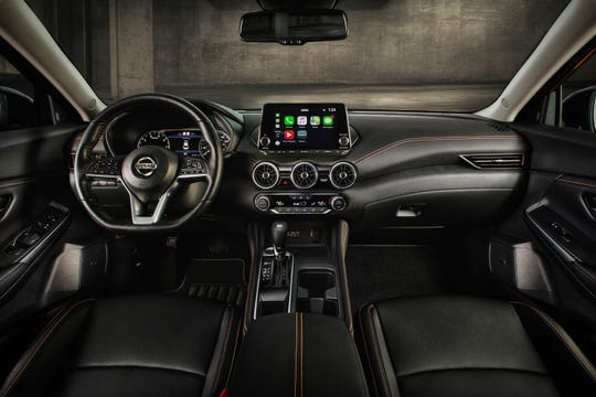 The 2020 Nissan Sentra's interior includes satin chrome aluminum accents, contrast seat stitching and a standard D-shaped steering wheel. (Nissan/TNS)