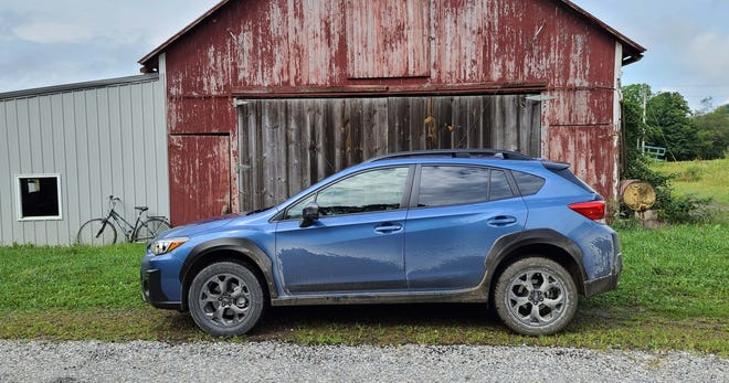 The 2021 Subaru Crosstrek Sport takes the  Impreza hatchback's profile -and basically jacks it up three inches.