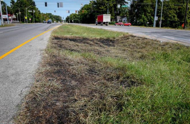 Burned grass marks the spot of the fiery fatal vehicle accident near the intersection of U.S. 41 and Covert Avenue that claimed three lives, Monday afternoon, the driver of the truck involved has been charged with three counts of reckless homicide Tuesday, September 22, 2020.
