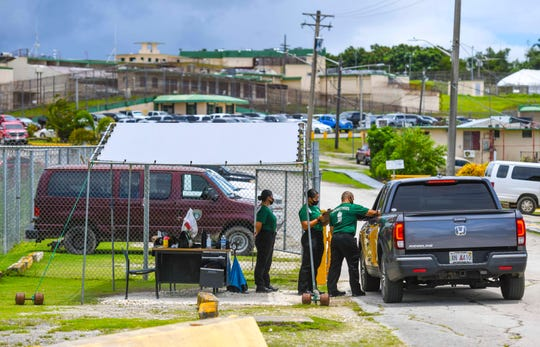 A vehicle is logged in by personnel at a checkpoint erected near the Department of Corrections' visitors center in Mangilao in this Sept. 22 file photo. Ni inmates or detainees at the Department of Corrections have tested positive for COVID-19.