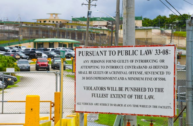 A sign, near the entrance to the Department of Corrections, warns of the penalties that can be imposed upon anyone found gulity of bringing contraband into the correctional facility in Mangilao, on Tuesday, Sept. 22, 2020.