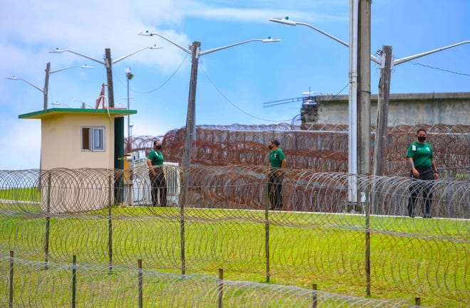 Personnel along the perimeter road that surrounds the Department of Corrections in Mangilao are shown in this Sept. 22 file photo. No inmates and detainees at the Department of Corrections have COVID-19.