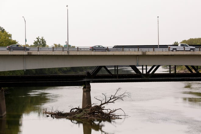 A row of cars travel across the Columbia Street bridge over the Wabash River, Tuesday, Sept. 22, 2020 in Lafayette.