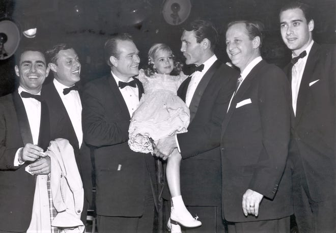Evelyn Rudie between Red Skelton and Jack Palance during the 1957 Emmy nominations.
