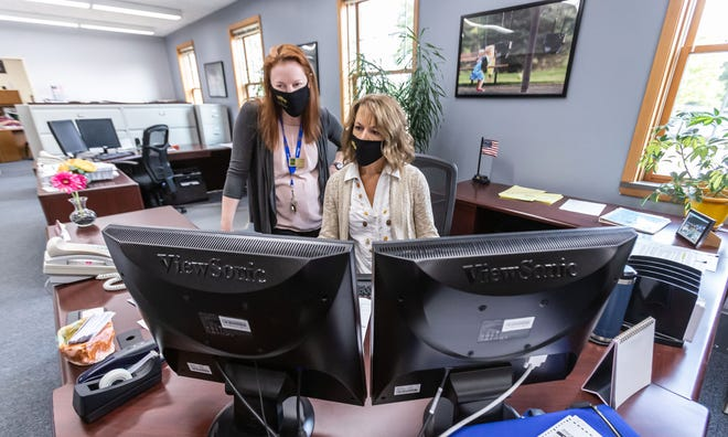 Village Clerk Michelle Luedtke, left, and Administrative Assistant Doreen Wiener work in the office at Elm Grove Village Hall on Monday, September 21, 2020.