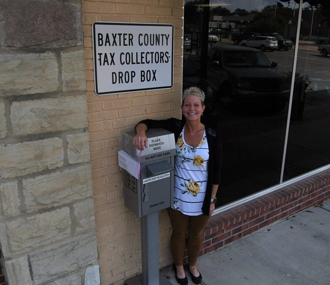 Baxter County Tax Collector Teresa Smith stands next to the drop box in front of her office that taxpayers can use to make payments after hours or to avoid waiting in line to pay in person. Property taxes are due on Oct. 15.