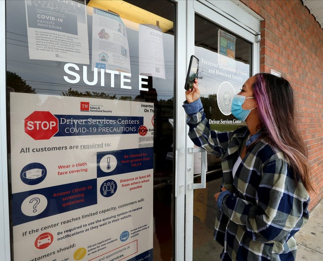 Crystal Kelley, 14, stops by the Driver Services Center on Tuesday, Sept. 22, 2020, in Murfreesboro to discover that it will be closed until Oct. 6. Kelley uses her phone on the Closed sign that also had a QR code attached.