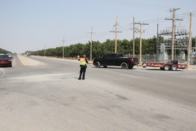 An Artesia police officer directs traffic on U.S. 285 north as a traffic accident forced commuters to take a different route on Sept. 21, 2020.