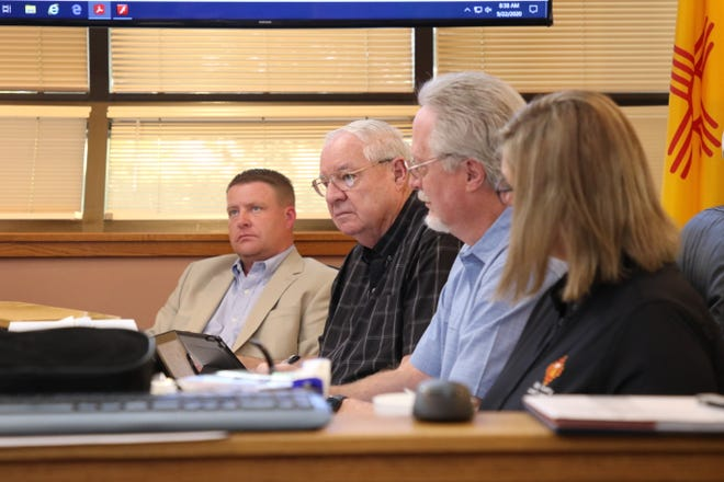 From left: District 2 Eddy County Commissioner Jon Henry, District 3 Commissioner Larry Wood, County Attorney Cas Tabor and Deputy Eddy County Clerk Darlene Rosprim listen to a discussion during the Sept. 22, 2020 Eddy County Board of County Commissioners meeting in Carlsbad.