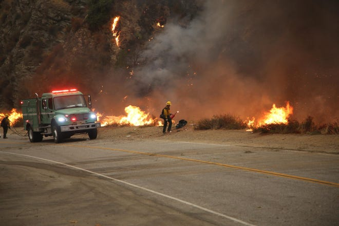 Firefighters set a prescribed burn ahead of the Bobcat Fire.