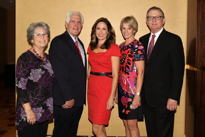 """Nancy Singer (left) poses with Richard Balocco, president and CEO of Desert Arc; Brooke Beare, board member and immediate past chair of the Desert Arc board; Lori Serfling, board member, and G. Aubrey Serfling, president and chief executive officer of Eisenhower Health, seen here at one of Desert Arc's """"Champions of Change"""" recognition award luncheons."""