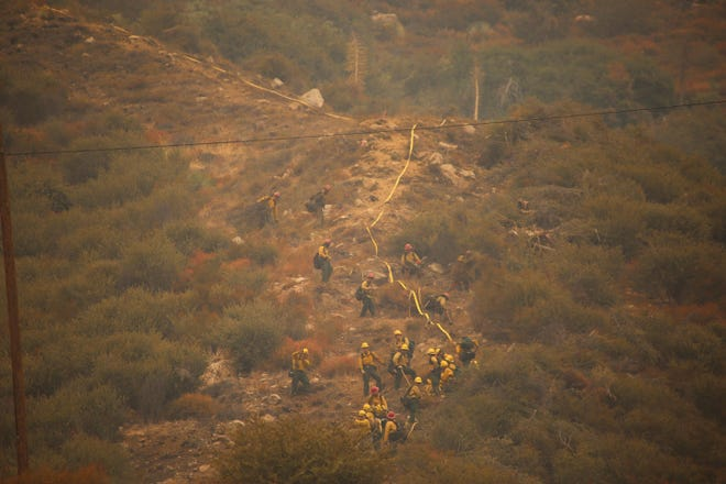 Firefighters are also battling the Bobcat Fire around the Angeles National Forest.
