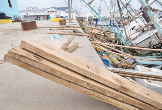 Several fishing boats that were badly damaged during Hurricane Sally await repair behind Joe Patti's Seafood in Pensacola on Sept. 22.