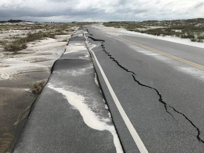 A 200 foot-stretch of Highway 399 cracked up almost to the center line following Hurricane Sally, which made landfall on Wednesday, Sept. 16, 2020. The National Parks Service confirmed the roadway will reopen 8 a.m. Friday after being closed for nearly five months.