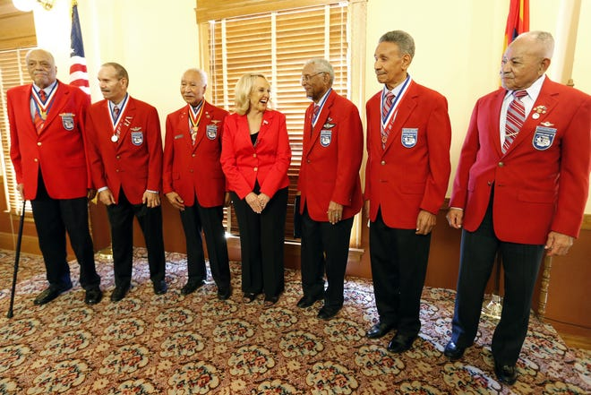 Former Arizona Gov. Jan Brewer stands with former members of the famed Tuskegee Airmen, including George W. Biggs on the far right, at an event in 2013.