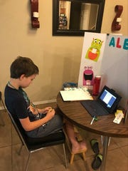 Student Alex Dorman, who is on the autism spectrum, needs assistance during online learning sessions, his mother says.