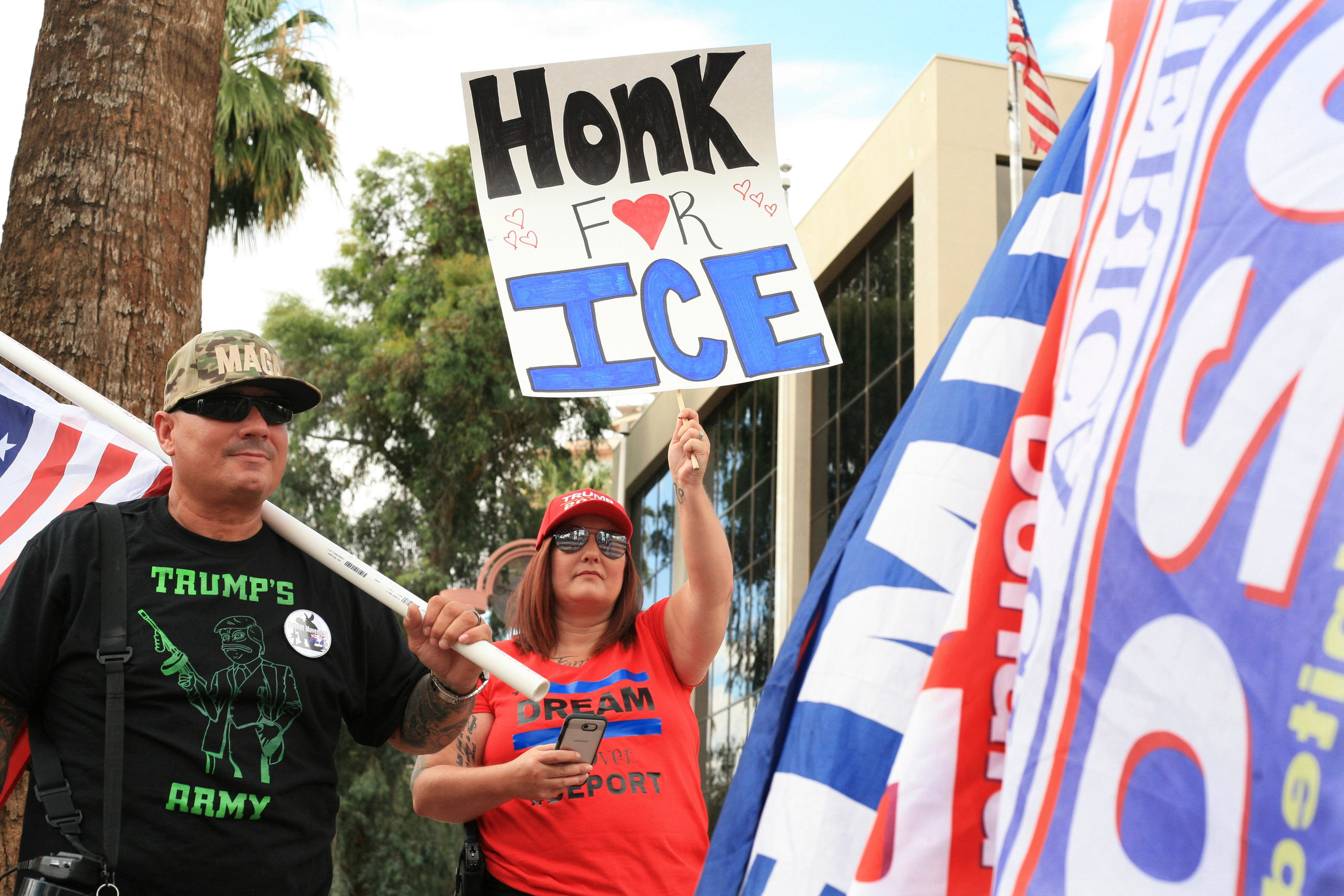 Members of Patriot Movement AZ gather outside of the U.S. Immigration Customs and Enforcement Removal Operations Field Offices in Phoenix on July 10, 2018.