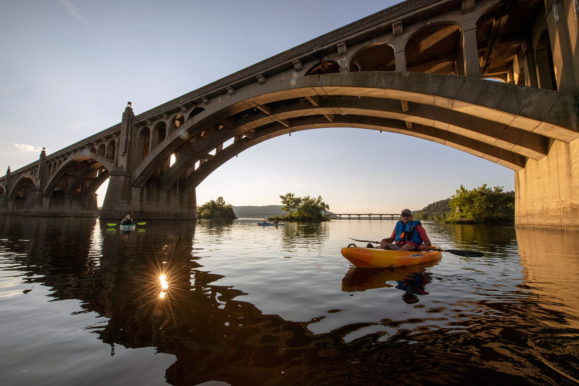 A paddler crosses under Veterans Memorial Bridge between Wrightsville and Columbia during a paddling tour organized by Shank's Mare Outfitters on August 8, 2020.