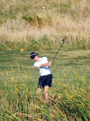 Washington's Lake Hamilton hits his ball over a water hazard in the final round of the Boys City Championship on Tuesday, September 22, at Prairie Green Golf Course in Sioux Falls.