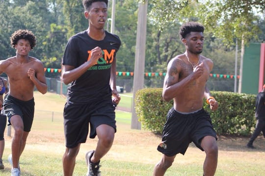 FAMU sprinter Brandon Love (center) works out with teammates at the Pete Griffin Track. Love is currently participating in the NFL Events & Club Business Development Experienceship Program.