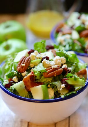 Apple Pecan Salad is flavor-packed with apples, pecans, bacon, dried cranberries, and blue cheese.