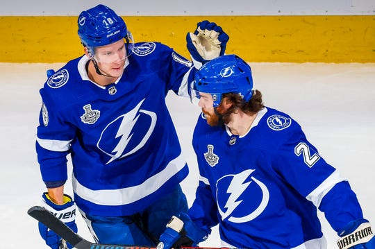 Tampa Bay Lightning left wing Ondrej Palat (18) and center Brayden Point (21) celebrate a goal against the Dallas Stars during the first period,