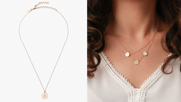 You can find similar initial necklaces at retailers like Nordstrom and Etsy.