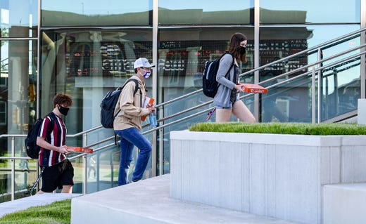 Clemson University students walk up stairs outside the new College of Business facility, during the first day of in-person classes for the fall semester in Clemson, S.C. Monday, September 21, 2020.