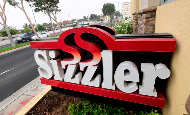 Commuters drive past a closed Sizzler restaurant in Montebello, California on September 22, 2020.