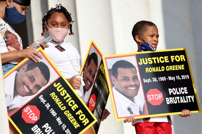 """In this Aug. 28, 2020 file photo, family members of Ronald Greene listen to speakers as demonstrators gather for the March on Washington, in Washington, on the 57th anniversary of the Rev. Martin Luther King Jr.'s """"I Have A Dream"""" speech. Officials told The Associated Press, federal authorities are investigating the death of Greene during what Louisiana State Police described as a struggle to take him into custody following a rural police chase last year. The death of the 49-year-old remains shrouded in secrecy because State Police have declined to release body-camera footage related to the May 2019 chase north of Monroe, La."""