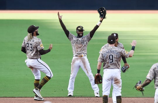 The surprising San Diego Padres -- especially Fernando Tatis Jr., left, Jurickson Profar, center, and Jake Cronenworth -- all made major contributions to fantasy teams' success this season.