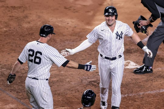 Luke Voit, right, has powered the New York Yankees to a 2020 playoff spot, leading the major leagues in home runs.
