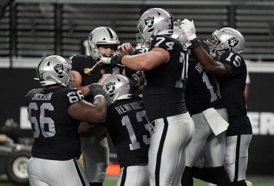 Las Vegas Raiders players celebrate a touchdown by wide receiver Zay Jones against the New Orleans Saints during the second quarter of a NFL game at Allegiant Stadium.