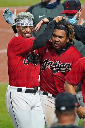 The Indians' Francisco Lindor, left, congratulates Jose Ramirez after Ramirez hit a three-run home run in the 10th inning against the Chicago White Sox, Tuesday, Sept. 22, 2020, in Cleveland. [Tony Dejak/Associated Press file]